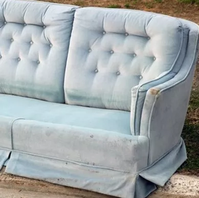 Old sofa in need of furniture removal services